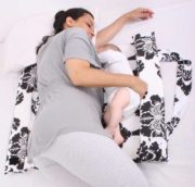 Mitata-co-sleeping-cot-breast-feeding-a-baby-in-bed