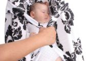 holding-a-baby-in-Mitata-portable-cot