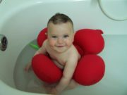 red Papillon bath seat with baby